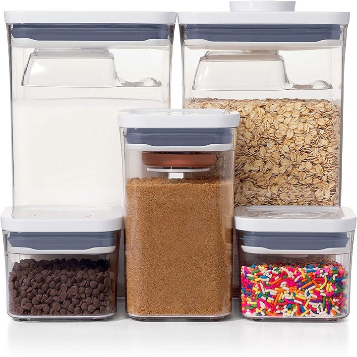 the eight piece set of clear containers with white lids