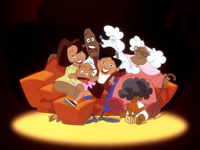 The Proud family and their dog on the couch