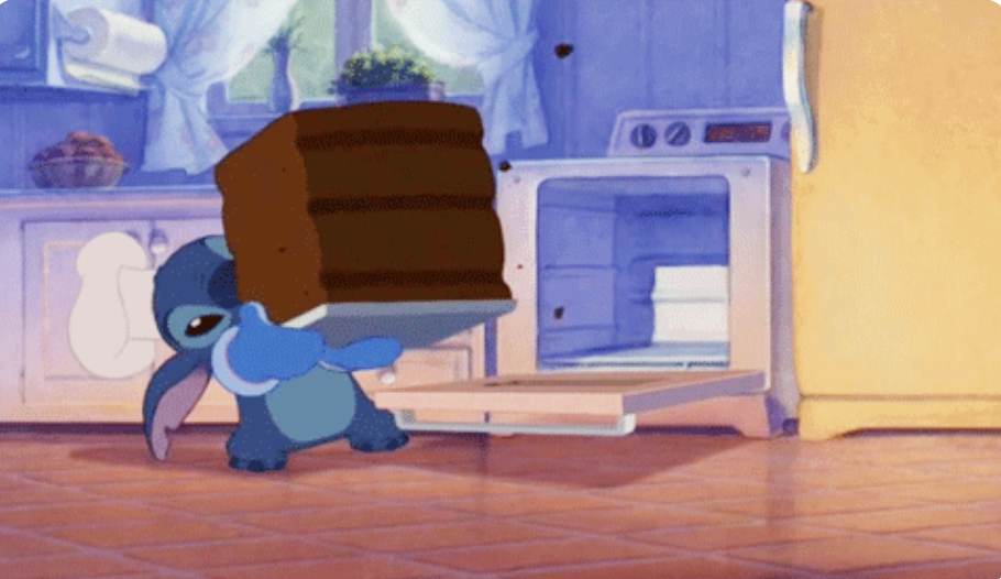 """Stitch from """"Lilo and Stitch"""" taking a big cake out of the oven"""