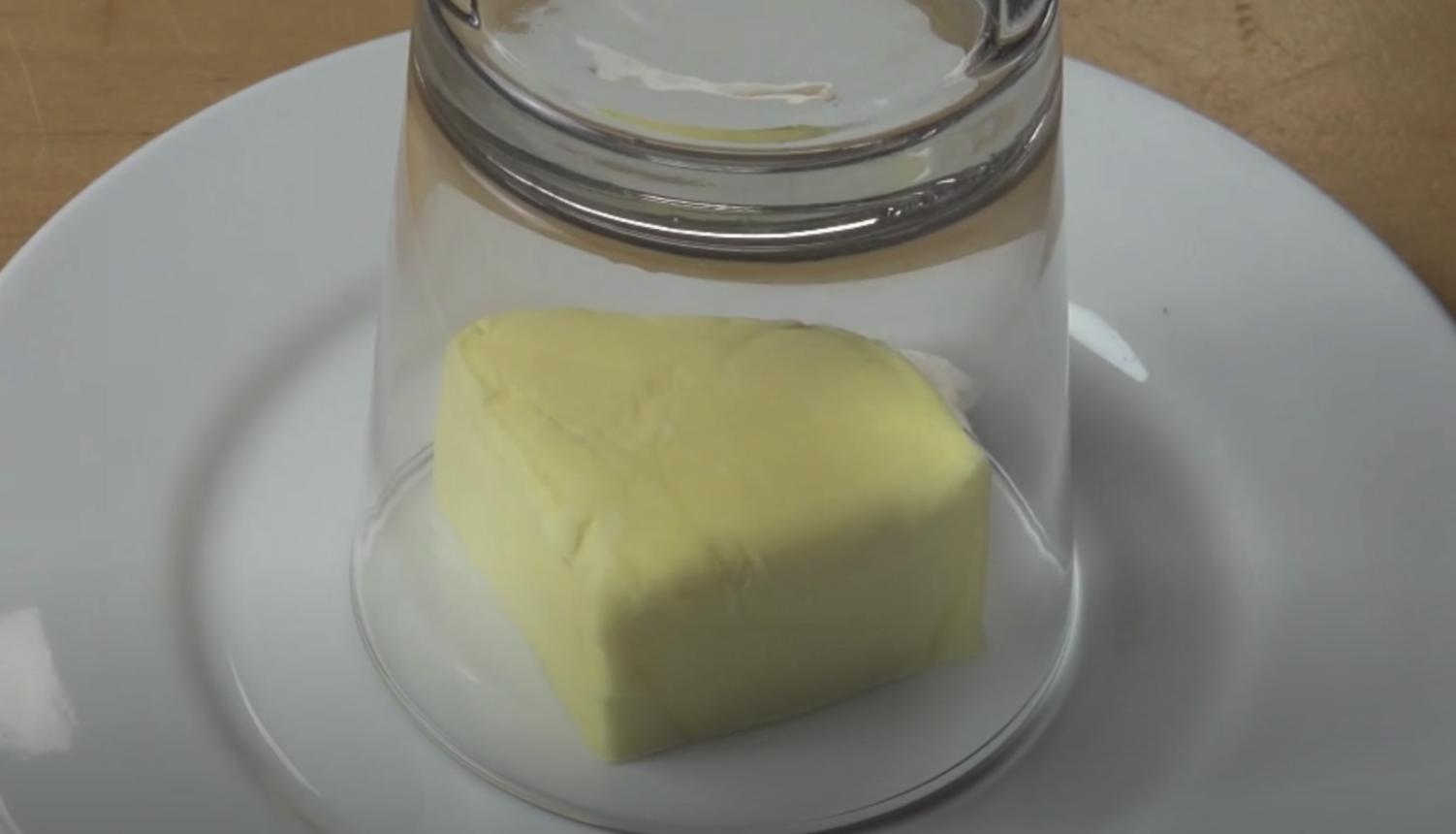 Butter underneath a hot glass