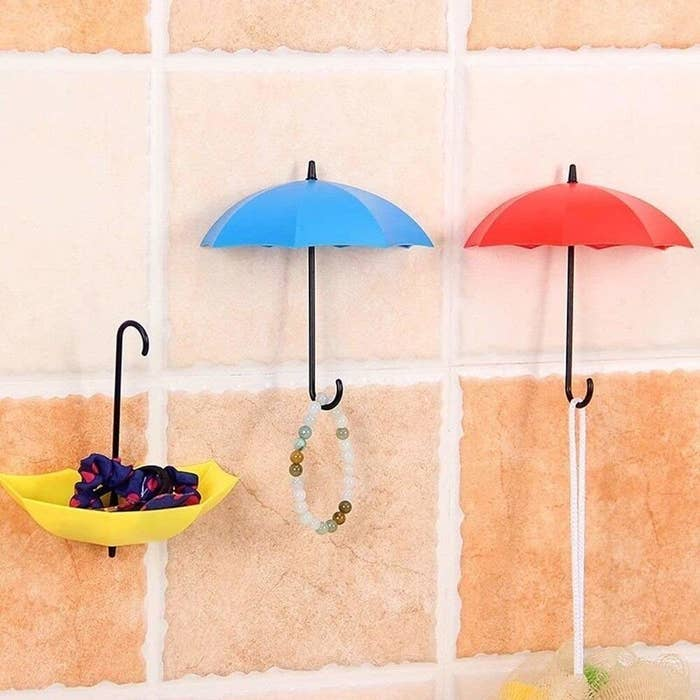 Umbrella hooks hanging on the wall.