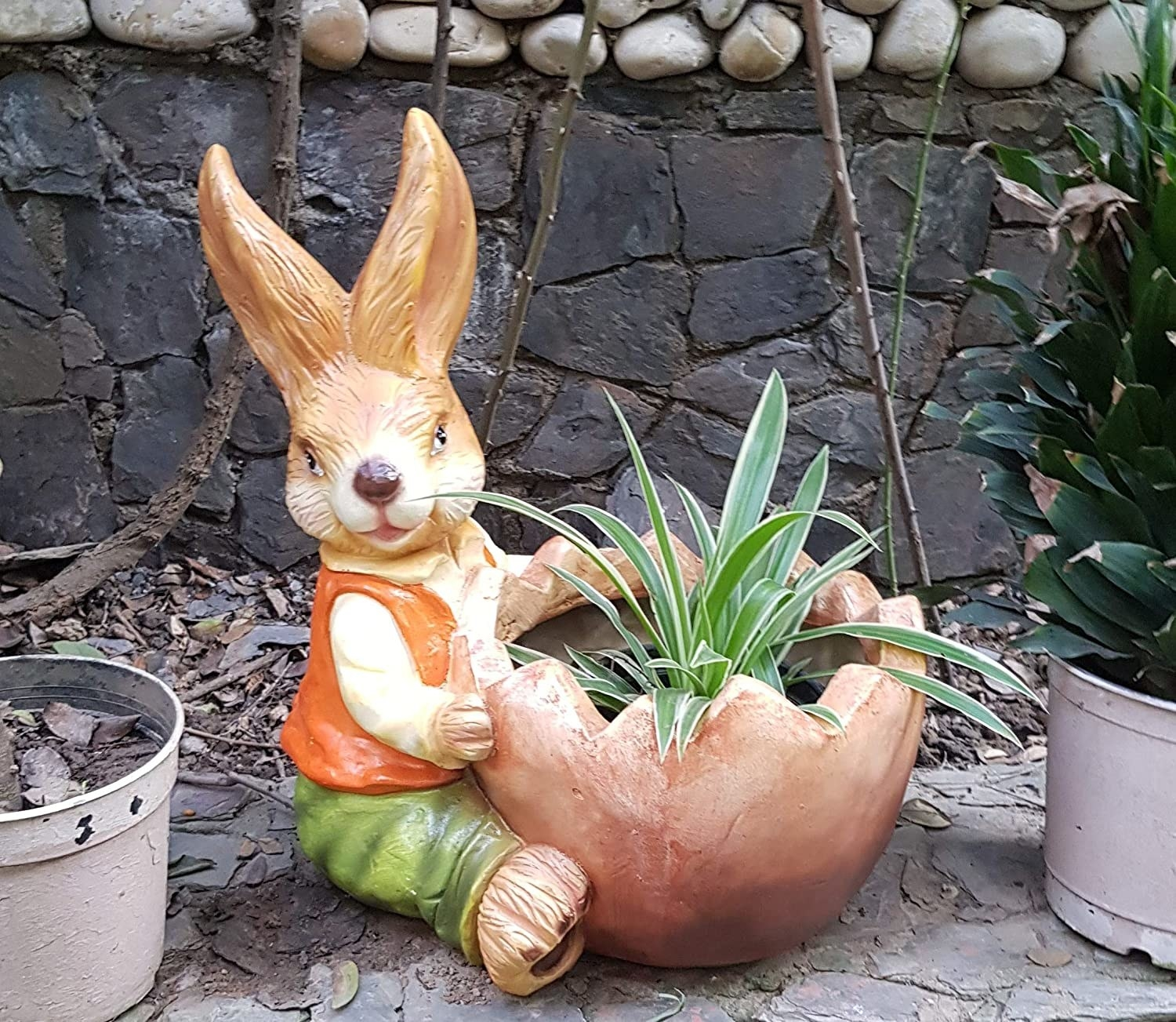 A planter in the shape of a bunny hugging a pot.