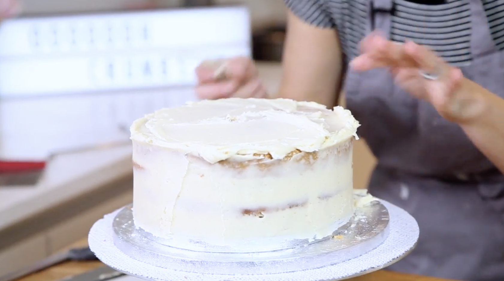 A thin layer of icing on a cake that's called a crumb coat