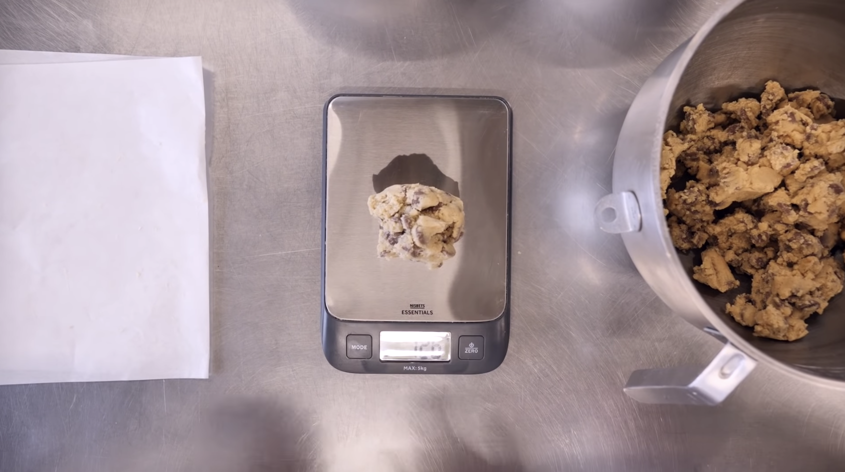 A ball of cookie dough on a digital scale