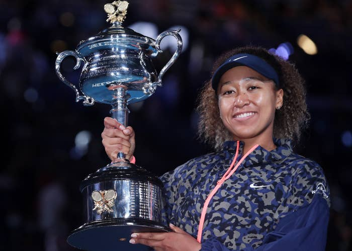 Naomi holds up her trophy at the Australian Open