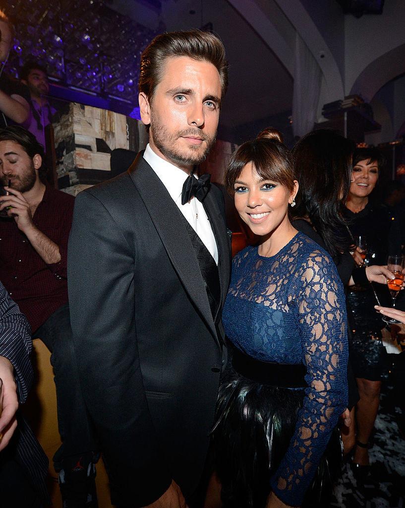 Scott Disick (L) and Kourtney Kardashian celebrate Scott's 30th birthday at a party in 2013