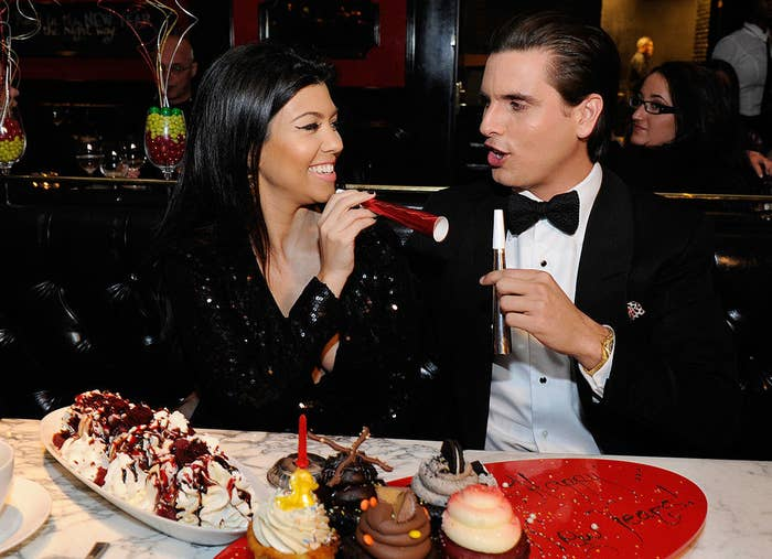 Kourtney Kardashian (L) and Scott Disick celebrate New Year's Eve at the Sugar Factory American Brasserie in 2011