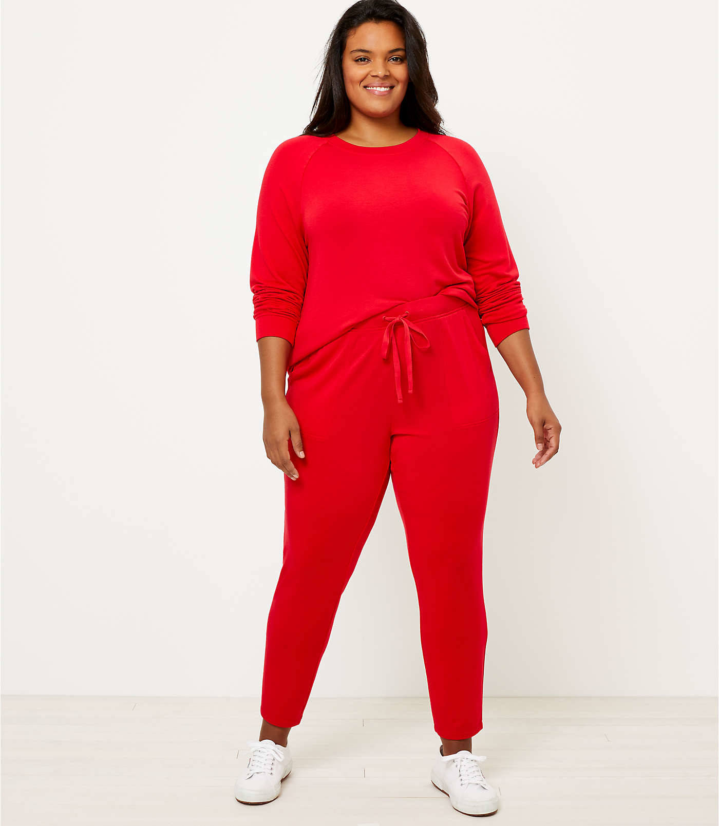 A model in the red sweatsuit