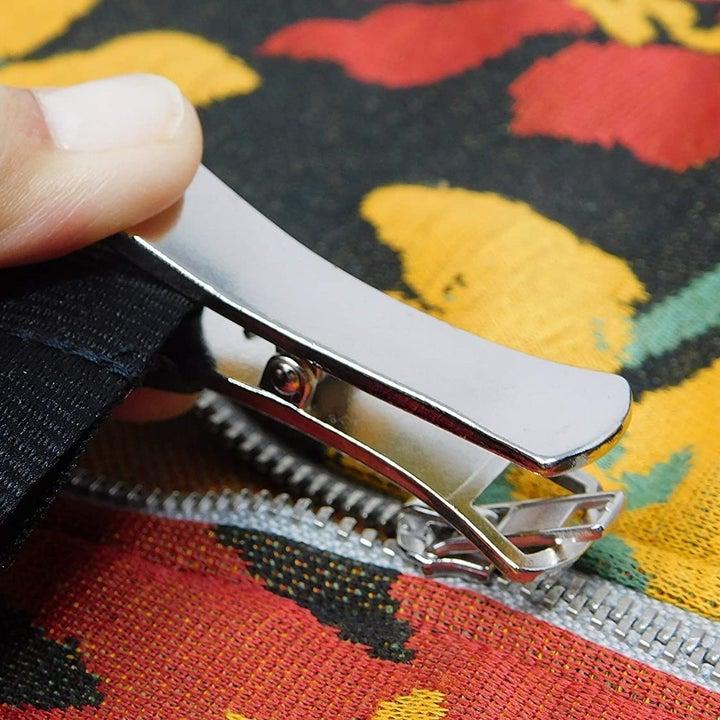Zipper puller fastening to a garment zipper