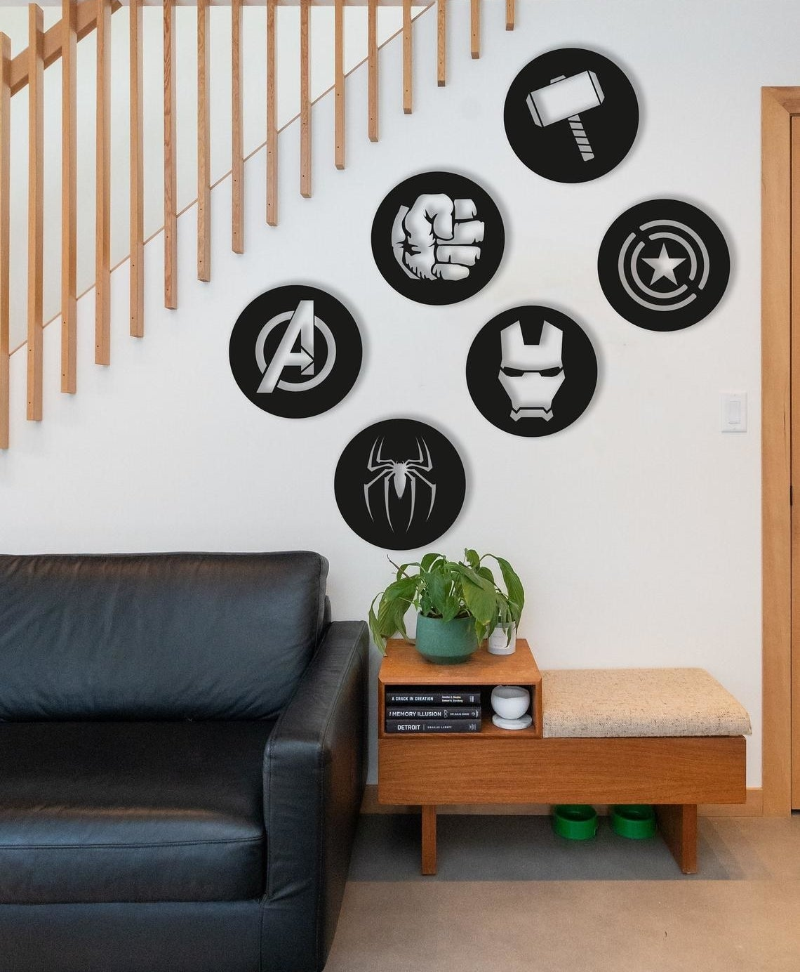 The six decor pieces hanging on a wall