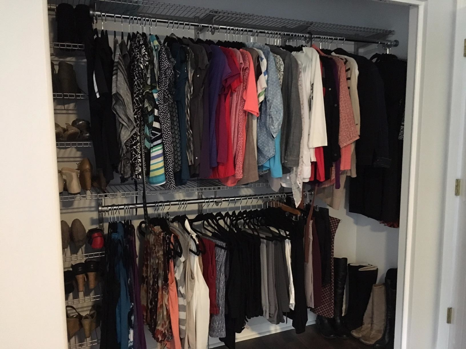 reviewer pic of the system in their closet with all their clothes and shoes organized