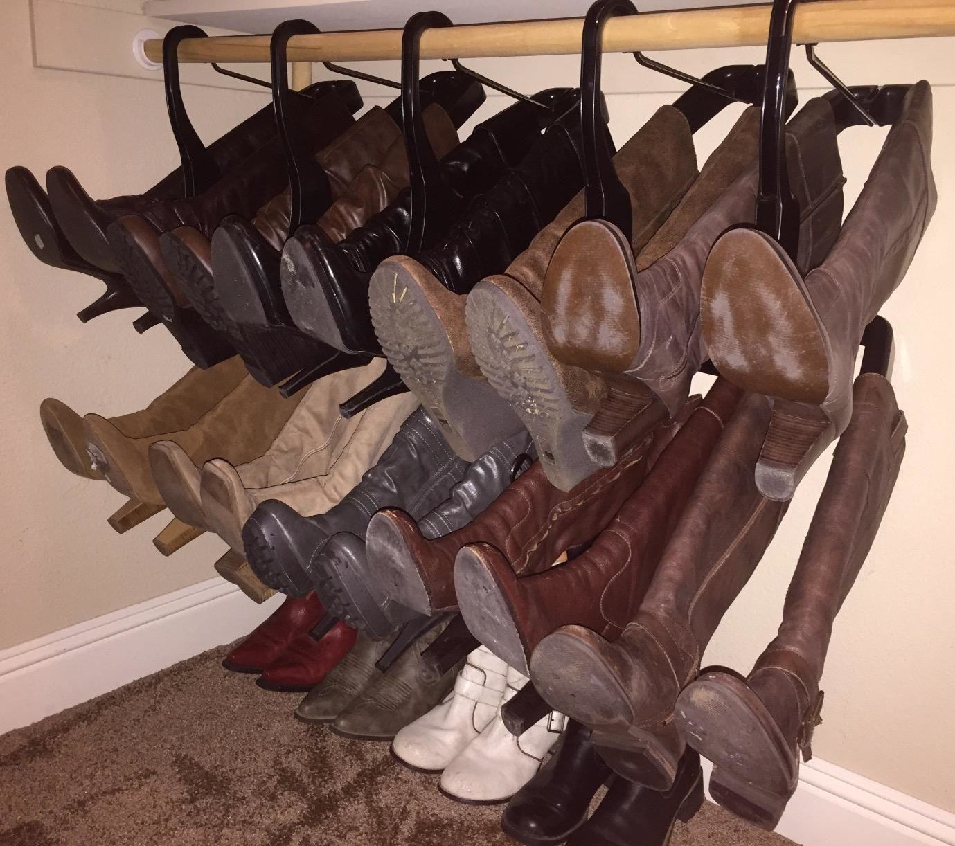 reviewer image of a bunch of boots hanging, taking up less space