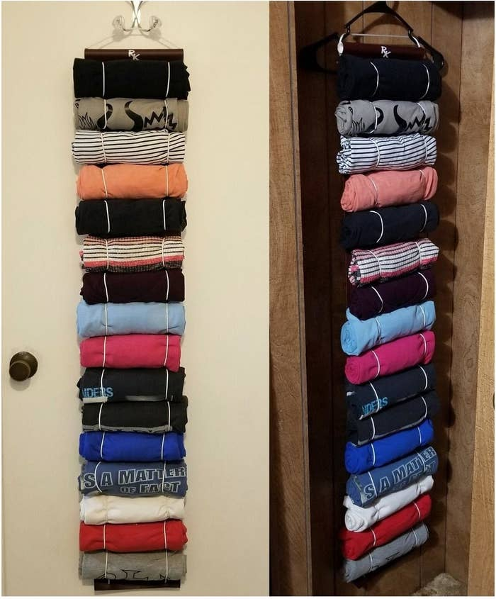 Long rectangular holder with hooks on the end and 16 t-shirts rolled being held in the keeper, all nice and organized