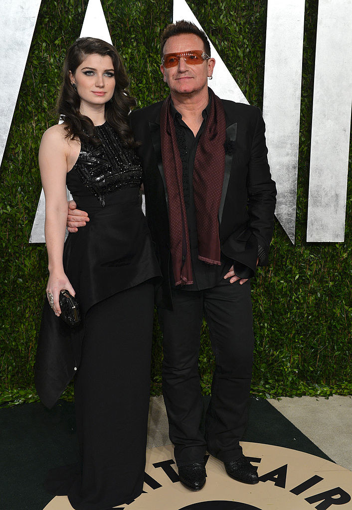 Eve and Bono posing for photographs at an event