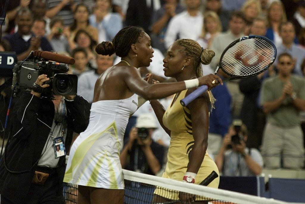 Venus and Serena Williams hug after Venus won the US Open September 8, 2001