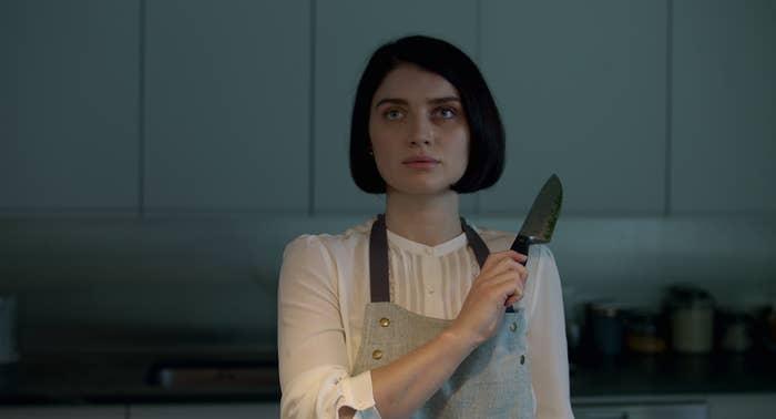 Adele menacingly holding up a knife