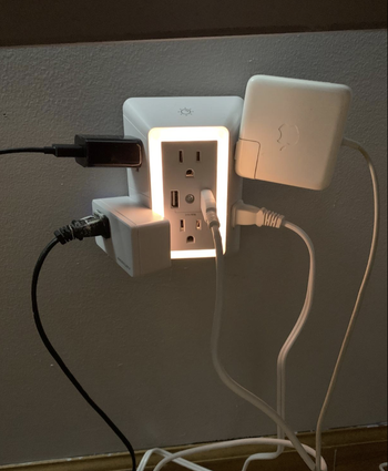 Charger with several large plugs in it
