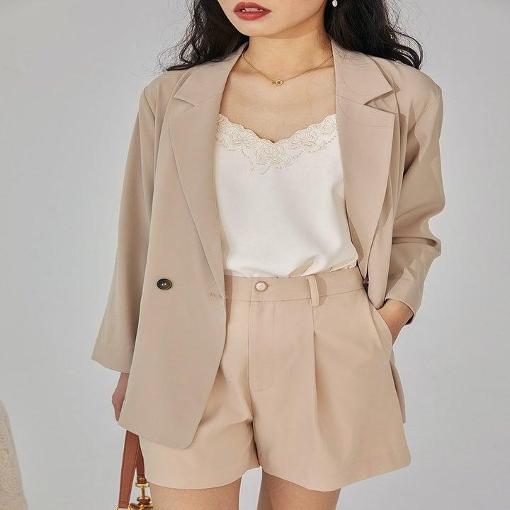 model wearing milk tea chiffon blazer over paper bag shorts and cami
