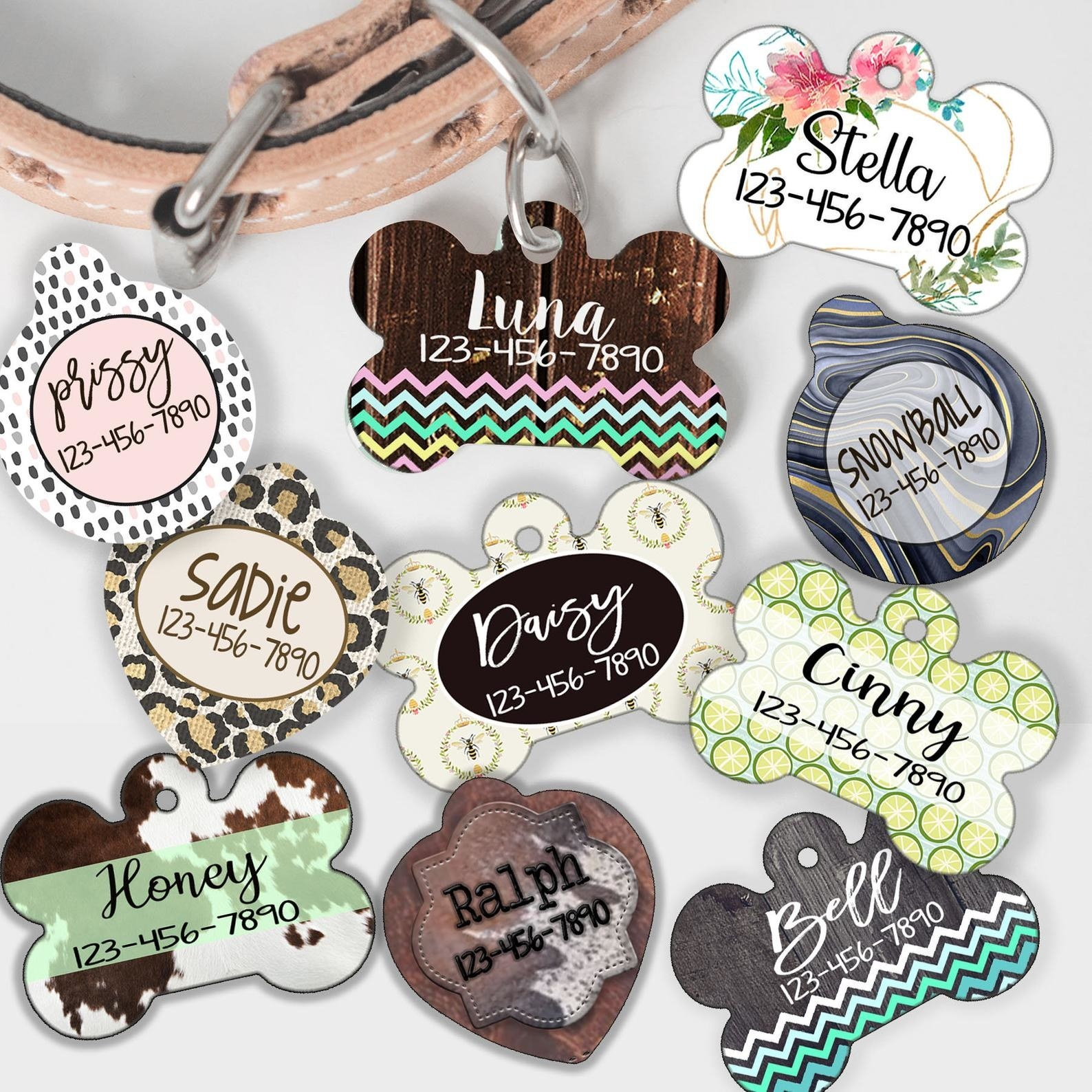 Ten dog tags in various shapes and patterns
