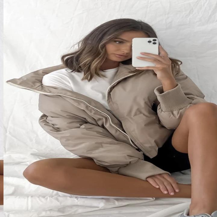 model wearing puffer jacket in mirror selfie