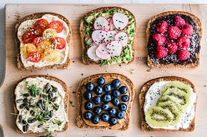 A platter of toast with different colorful toppings