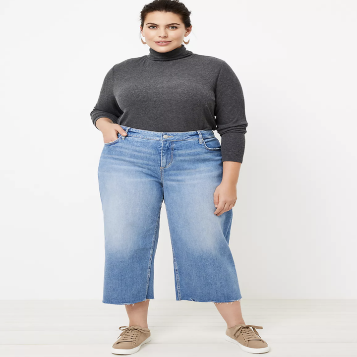 model wearing wide leg jeans with sneakers and turtleneck