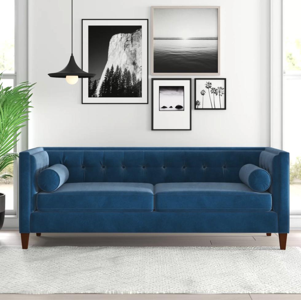 The blue velvet sofa in a living room