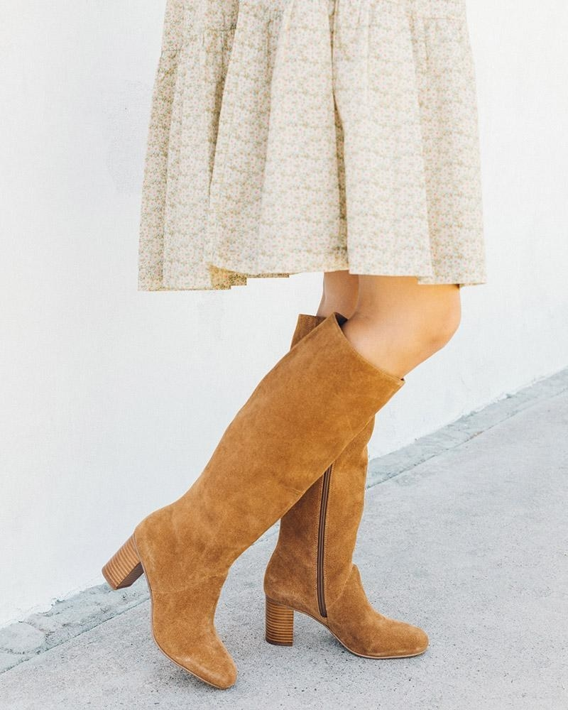 model wearing tall boots with heel