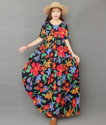 model in large long dress with colorful flowers