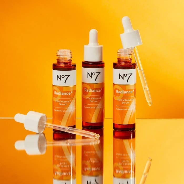 bottles of the vitamin C serum styled on a mirror