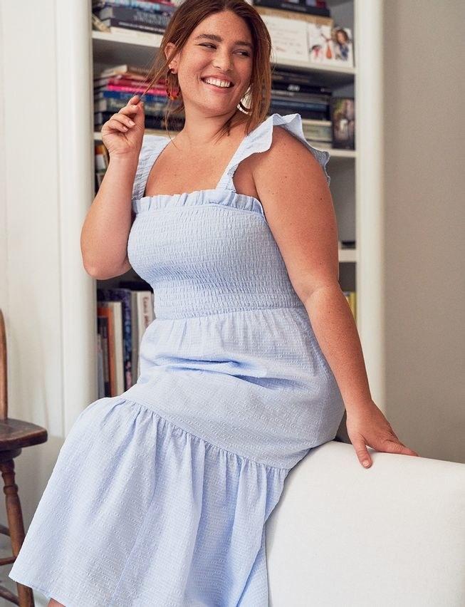 model wearing smocked long dress with ruffle tank sleeves