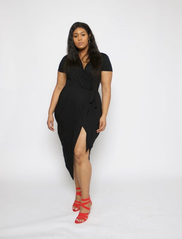 model wears mini dress with wrap top