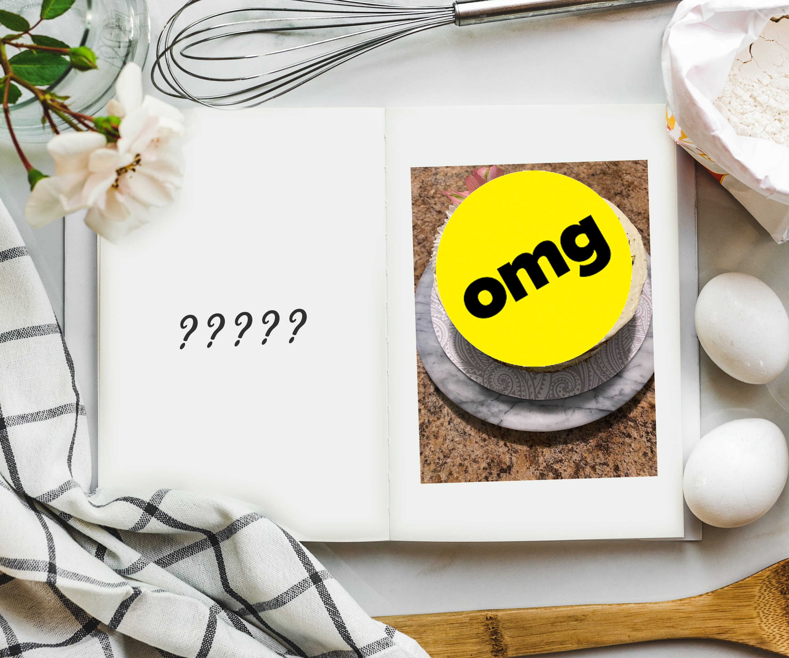 An overhead shot of cookbook on a table surrounded by ingredients and a photo on the inside that is covered with a sticker that says OMG.