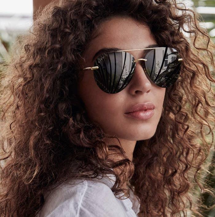 model wearing aviator style glasses