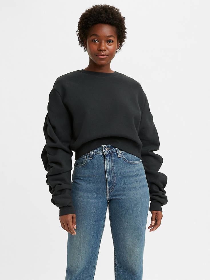 A model in the black sweatshirt with dramatic sleeves
