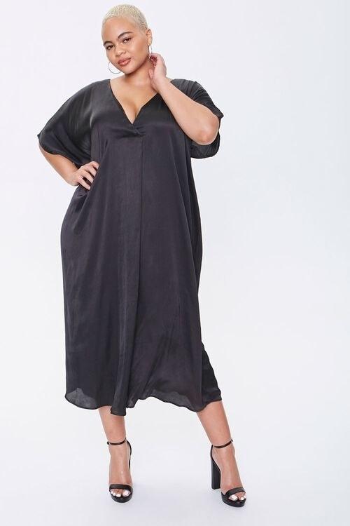 A model in the black dolman-sleeve dress