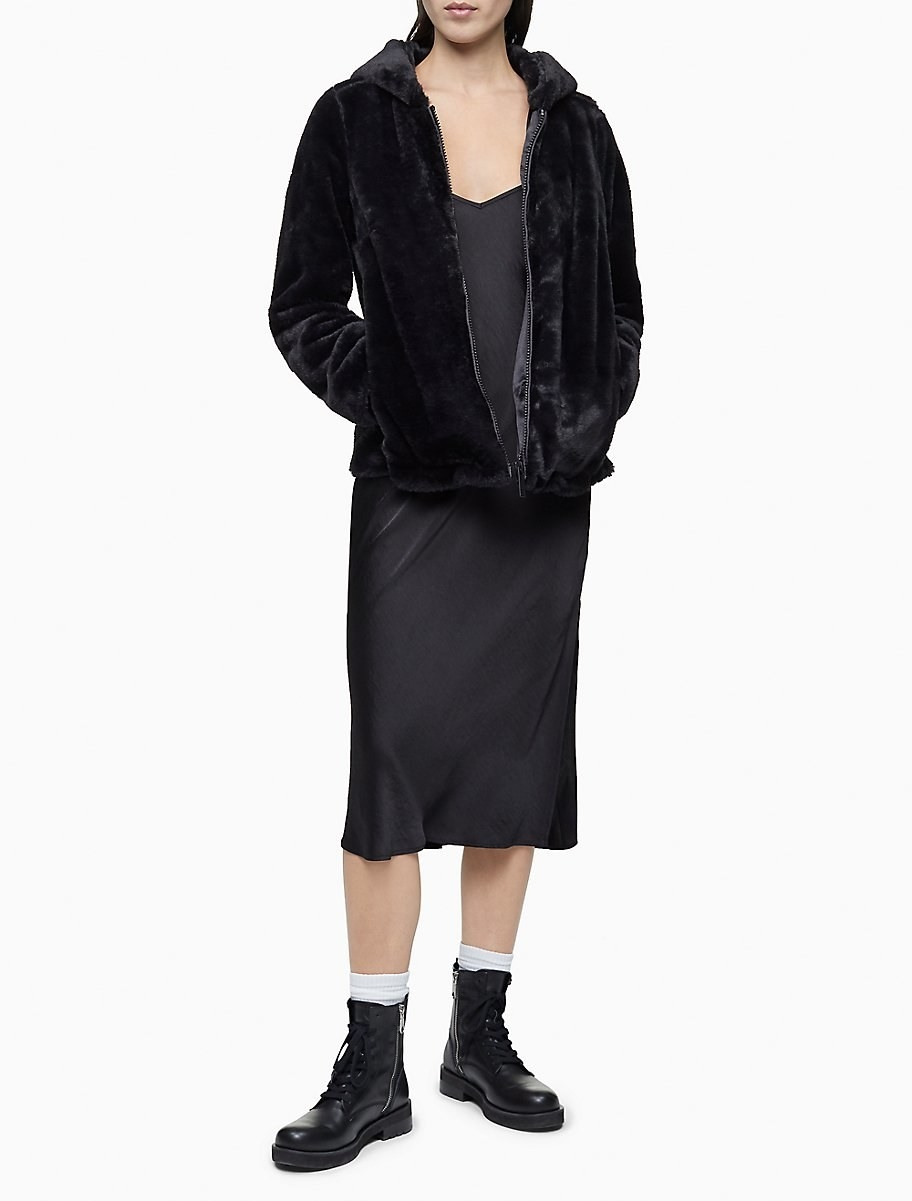 A model in the black hoodie