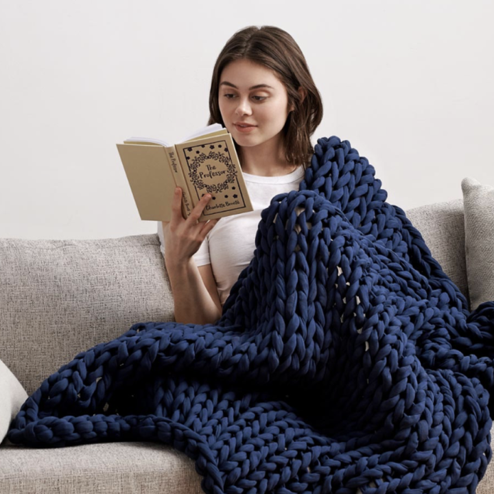 Blanket on women on couch