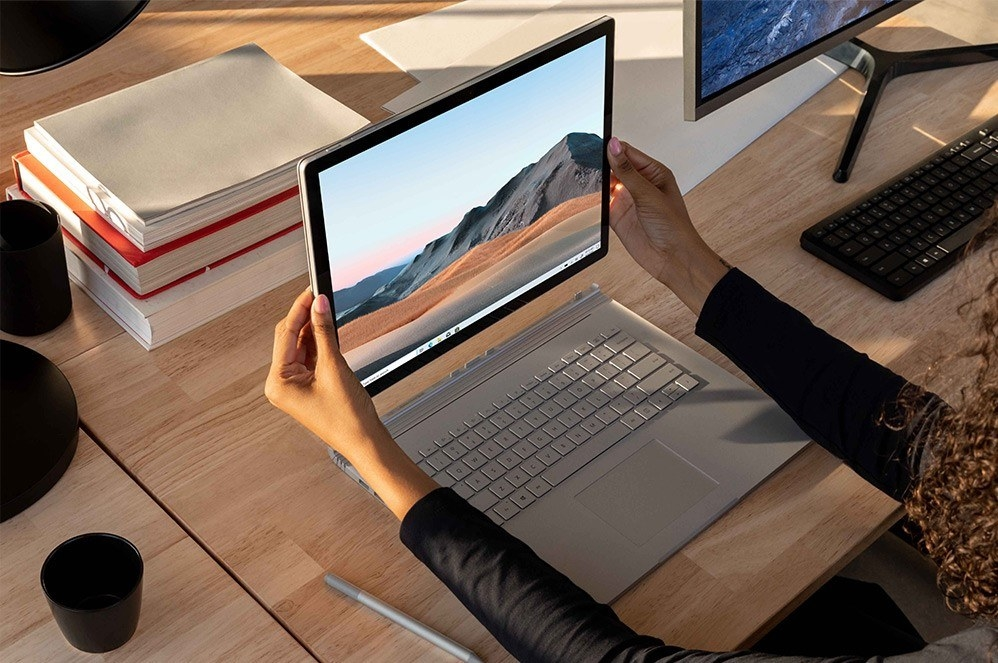 the silver surface book laptop with the screen detached