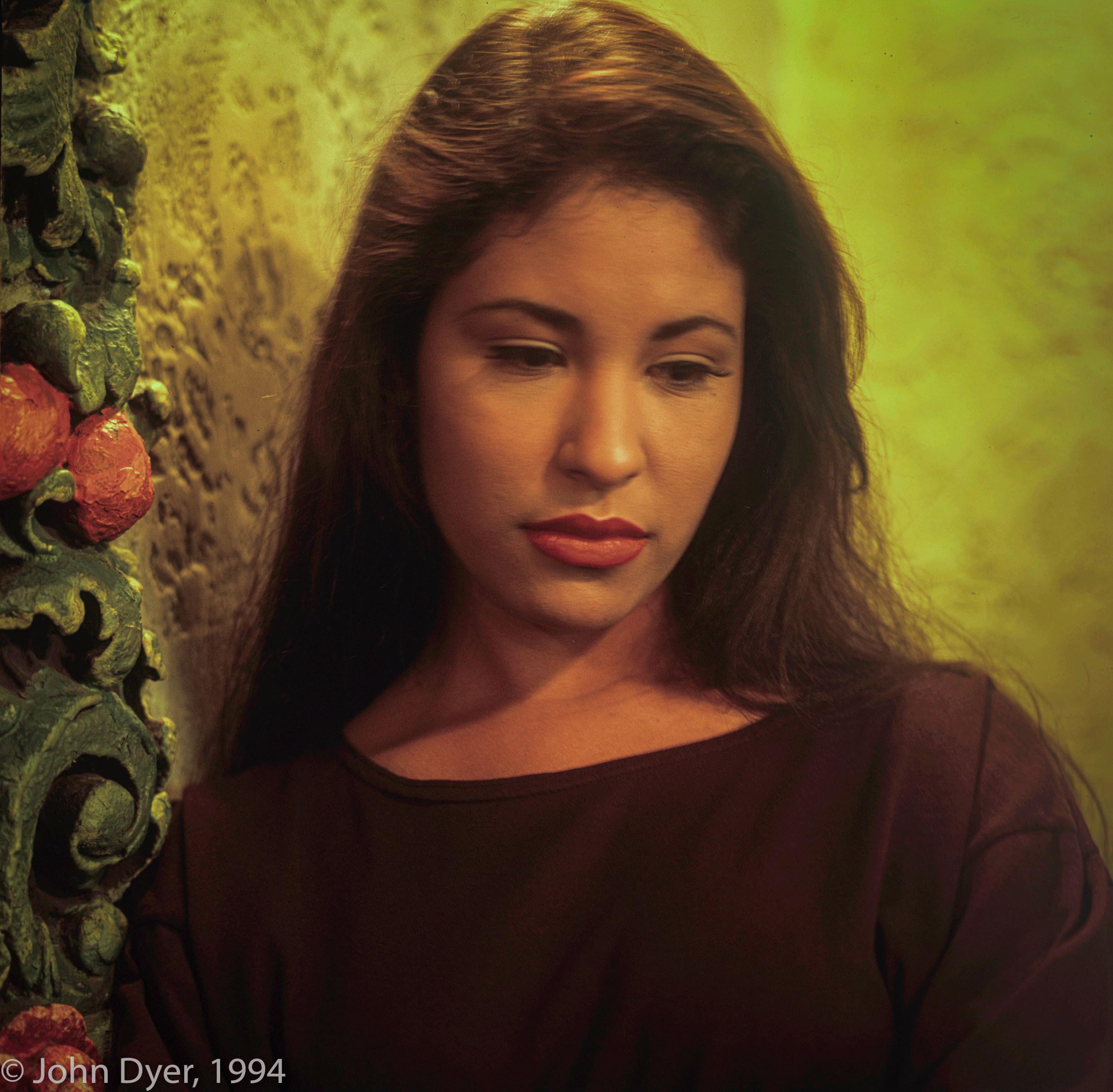 selena quintanilla looking somber while wearing a black shirt