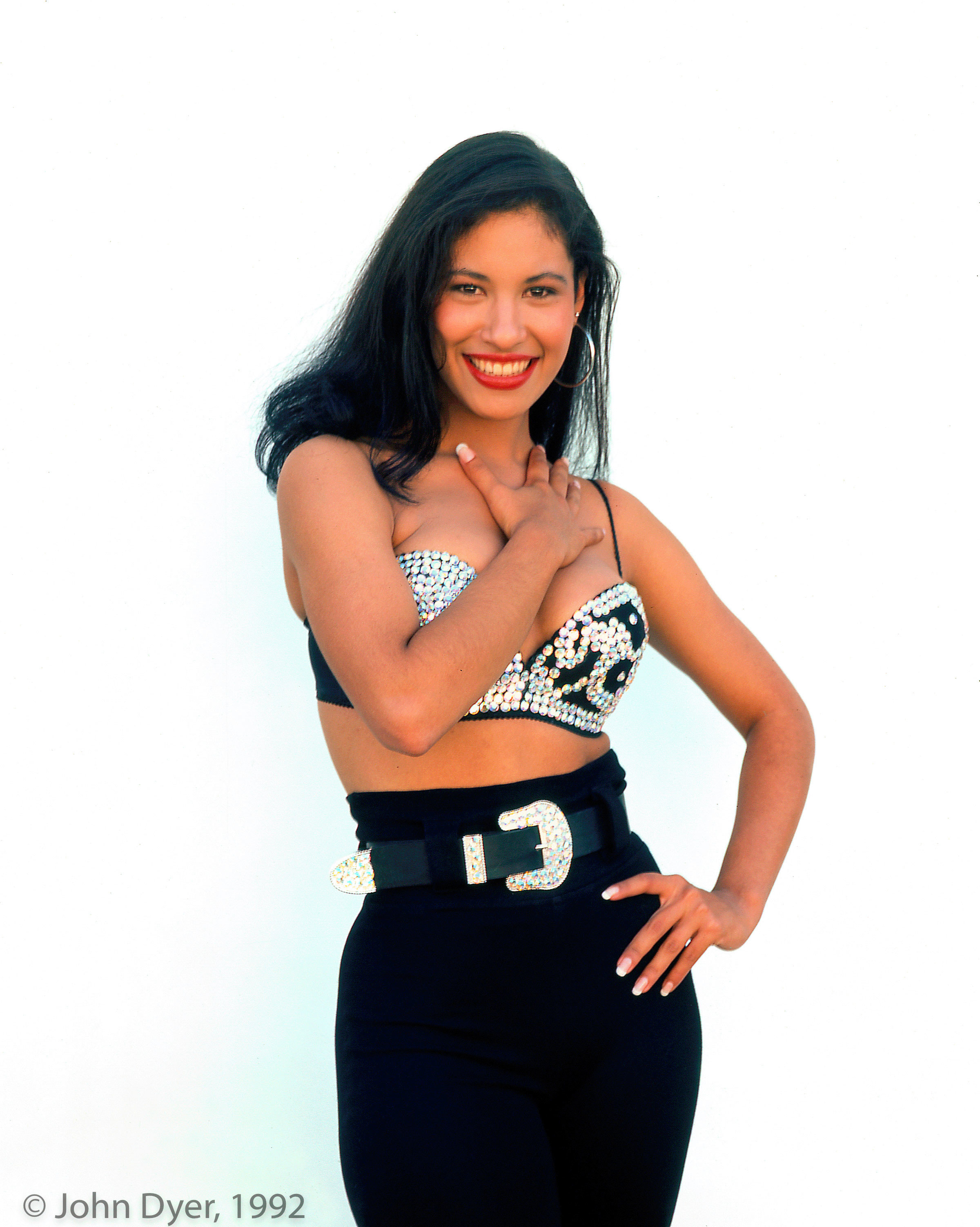 selena quintanilla smiling while standing for a photo