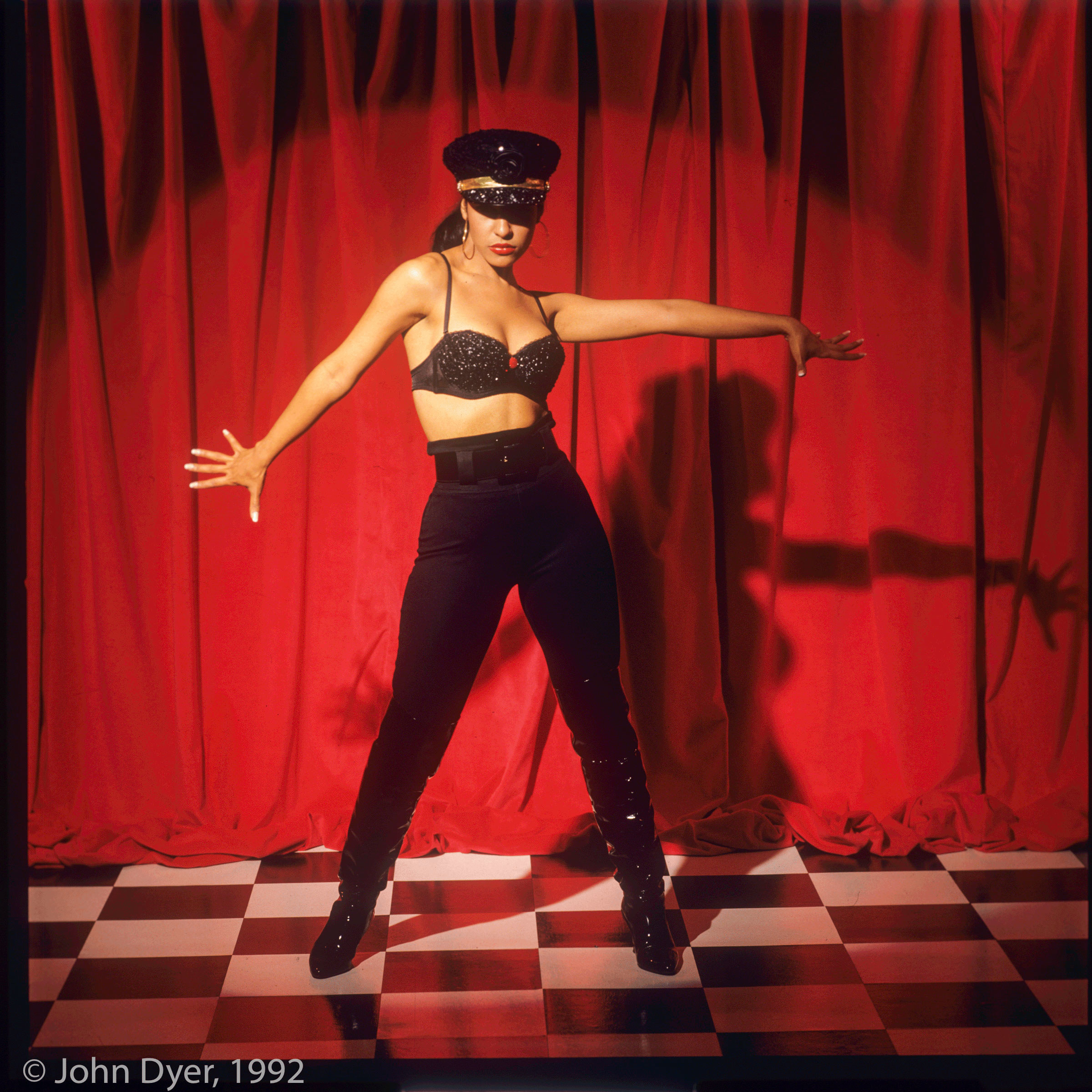 selena quintanilla posing for the camera with her hands out
