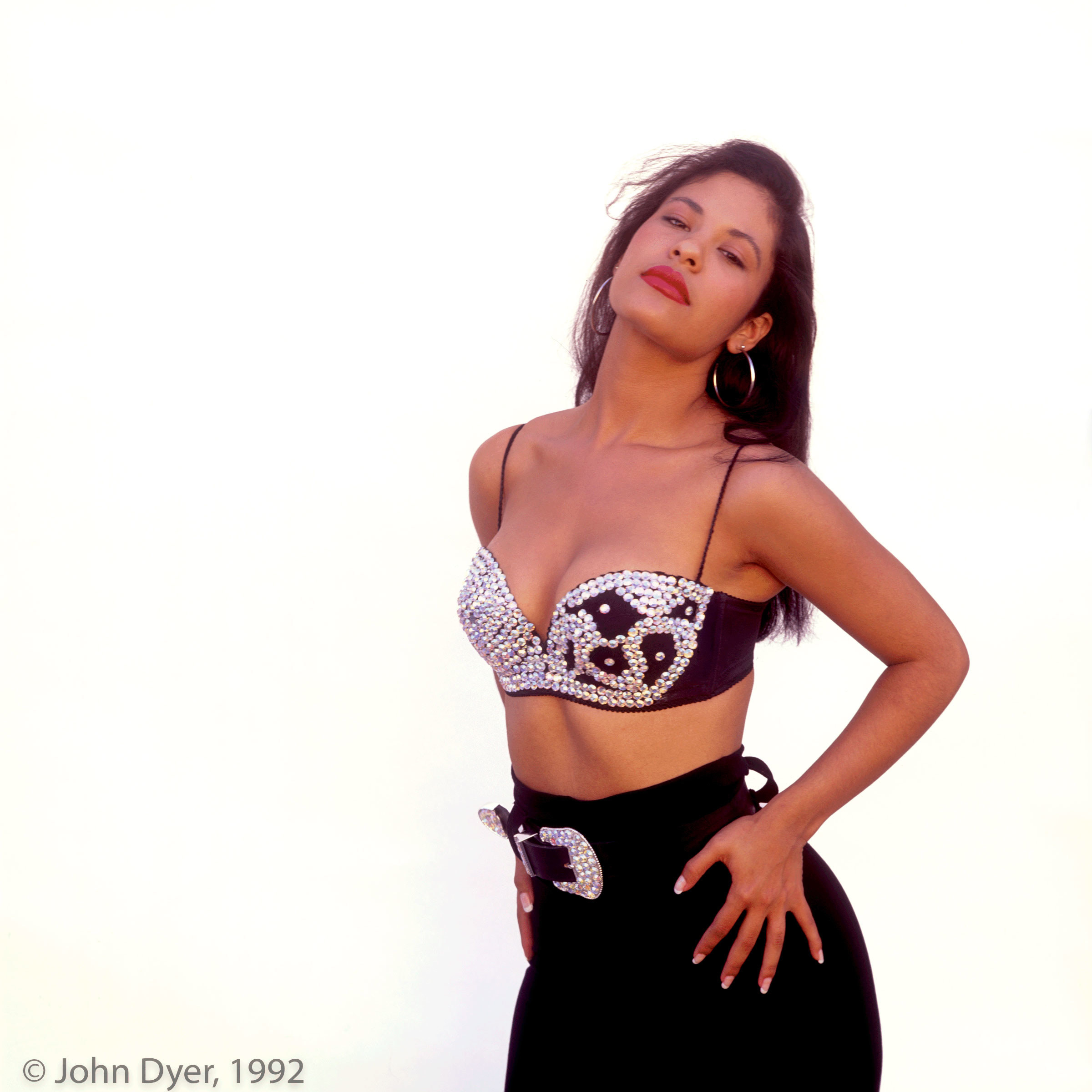selena quintanilla posing for the camera in front of a white backdrop
