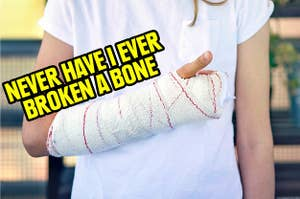 a child with a broken arm in a cast