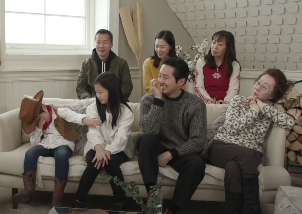 The cast of Minari on a couch looking at Alan dabbing