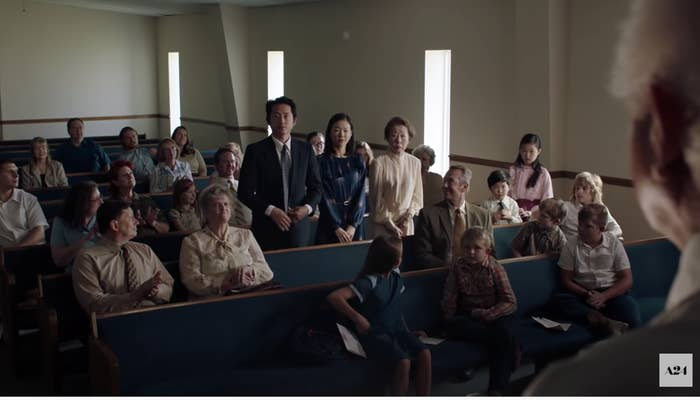 The family in Minari standing as new members of their church