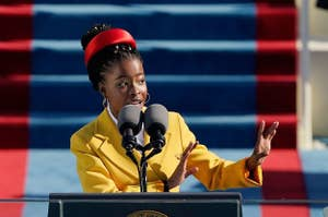 Amanda Gorman, in yellow jacket and red headband, speaking at the 2021 Presidential Inauguration.