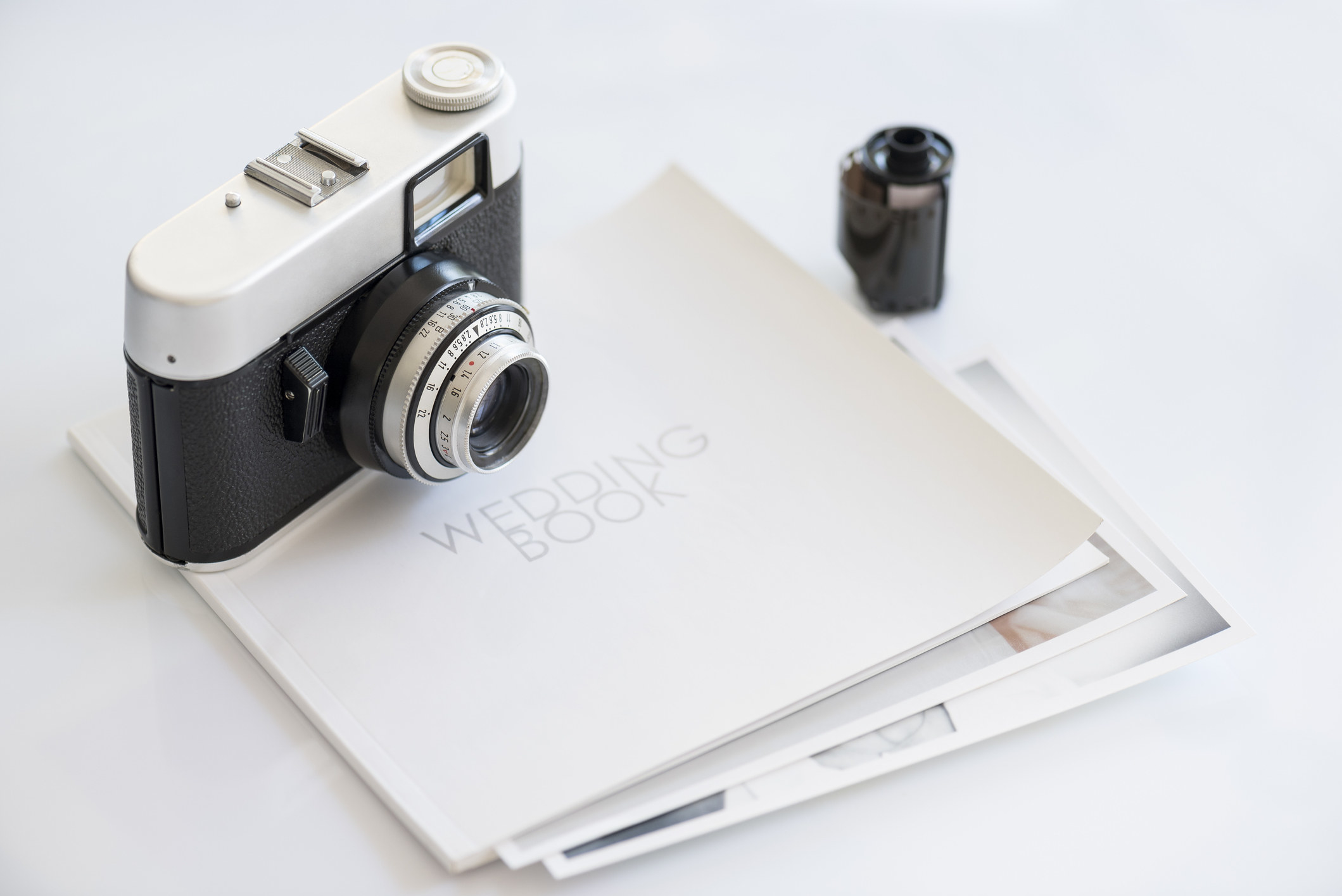 Vintage camera and a wedding photo book