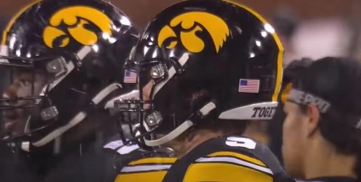 Black helmet with a yellow hawkeye head logo
