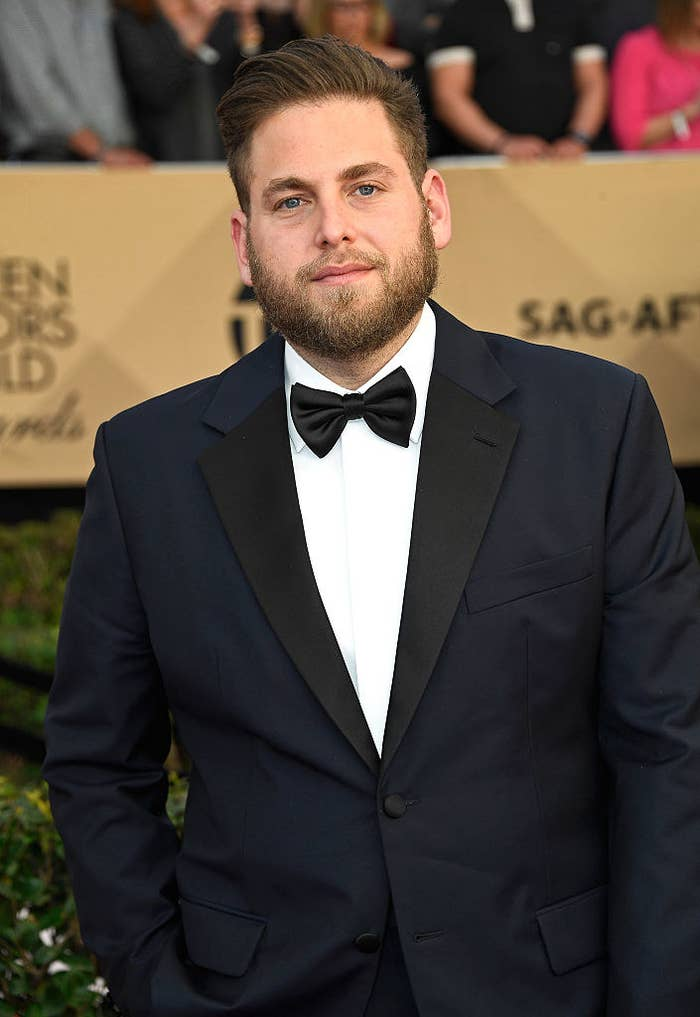 Jonah posing on the red carpet in a tux